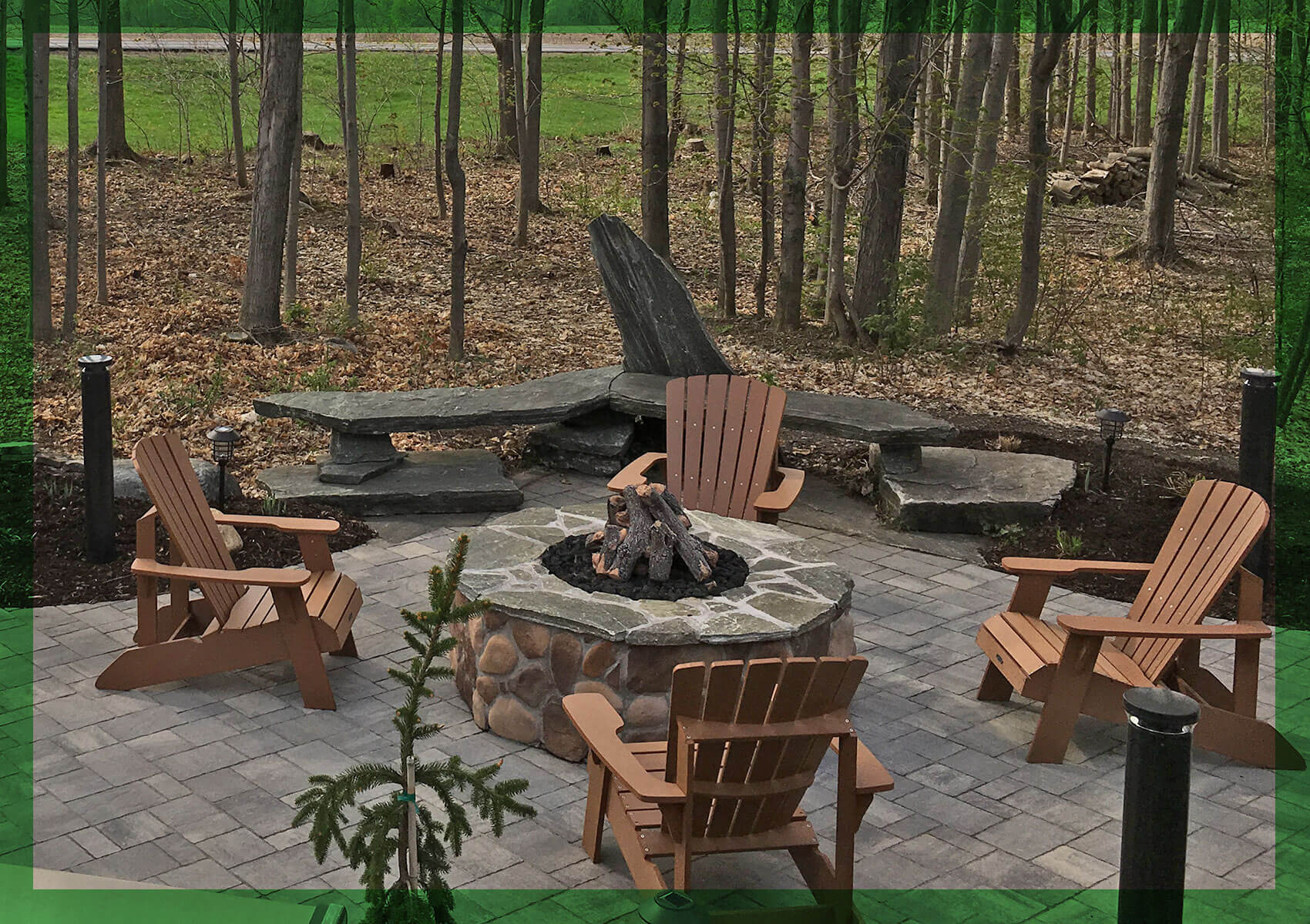 Adirondack chairs around an outdoor fireplace in Central New York