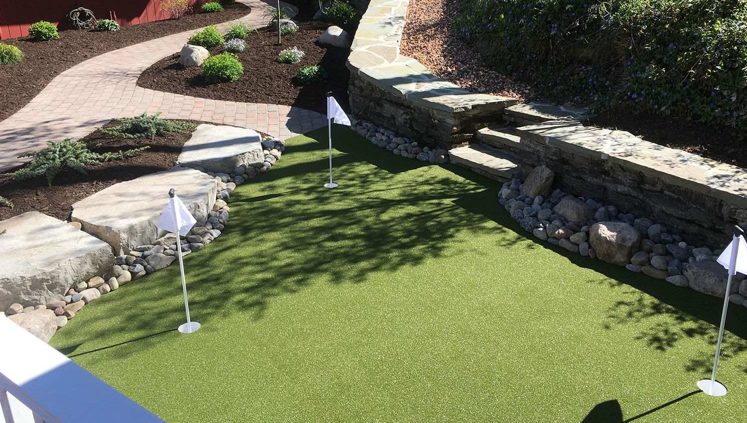 Custom putting green installation at a Central New York home