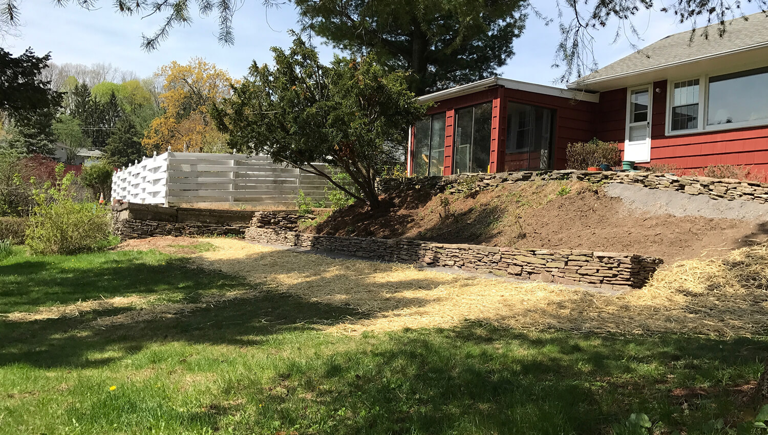 A sturdy and well designed retaining wall at a central new york home