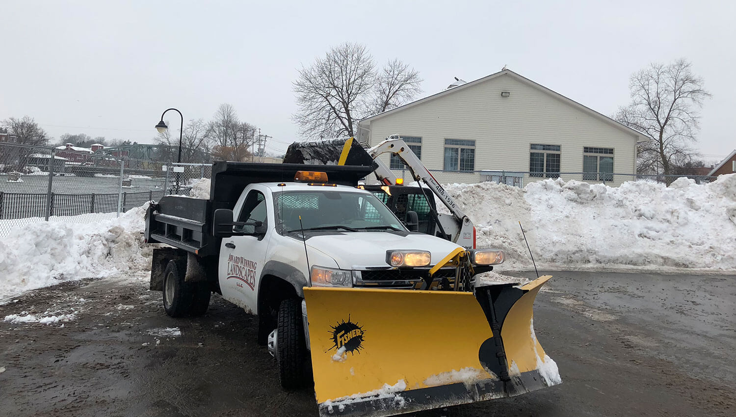 Commercial snow removal vehicles during a Central New york Winter